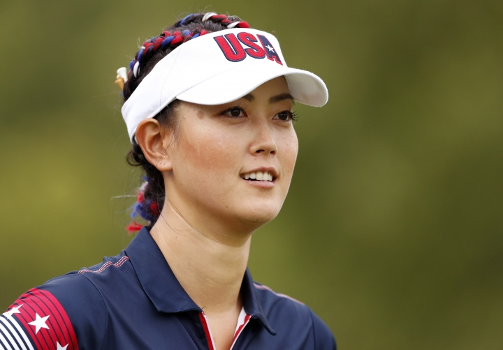 FILE - In this Aug. 16, 2017, file photo, United States' Michelle Wie walks off the 18th tee during practice for the Solheim Cup golf tournament in West Des Moines, Iowa. Michelle Wie sunk a lengthy putt from off the green on the final hole to win the LPGA's Women's World Championship by one stroke on Sunday, March 4, 2018. (AP Photo/Charlie Neibergall, File)