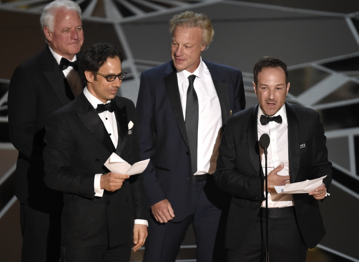 "James R. Swartz, from left, Dan Cogan, David Fialkow, and Bryan Fogel accept the award for best documentary feature for ""Icarus"" at the Oscars on Sunday, March 4, 2018, at the Dolby Theatre in Los Angeles. (Photo by Chris Pizzello/Invision/AP)"