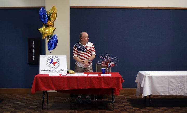 In this Tuesday, Feb. 13, 2018, photo, Kerry Ledford mans a booth at a Republican congressional candidate forum, in New Braunfels, Texas. Texas holds the nation's first 2018 primary elections Tuesday, March 6, 2018, and the campaign is providing a vivid exhibition of the Trump effect in GOP politics. (AP Photo/Eric Gay)