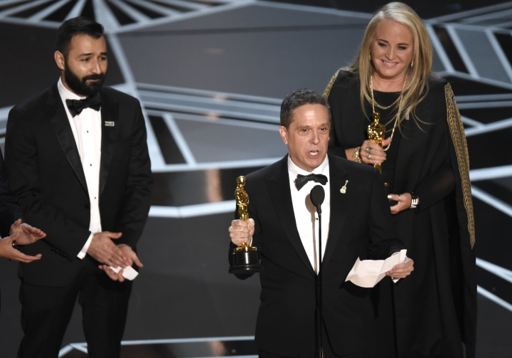 "Adrian Molina, from left, Lee Unkrich, and Darla K. Anderson accept the award for best animated feature film for ""Coco"" at the Oscars on Sunday, March 4, 2018, at the Dolby Theatre in Los Angeles. (Photo by Chris Pizzello/Invision/AP)"