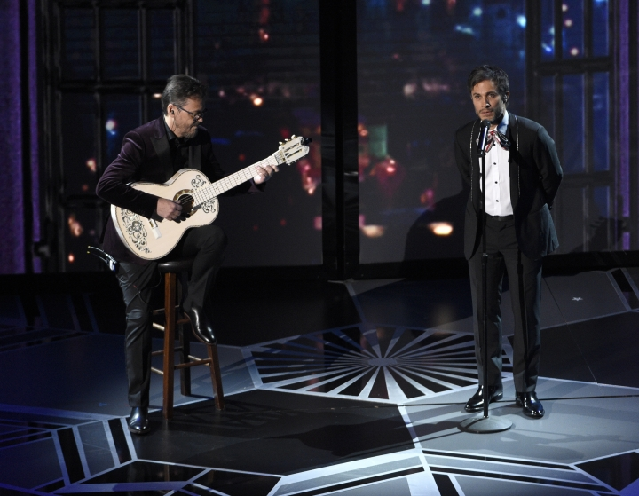 """Gael Garcia Bernal performs """"Remember Me"""" from """"Coco"""" at the Oscars on Sunday, March 4, 2018, at the Dolby Theatre in Los Angeles. (Photo by Chris Pizzello/Invision/AP)"""