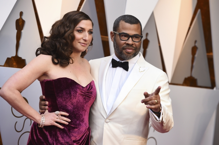 Chelsea Peretti, left, and Jordan Peele arrive at the Oscars on Sunday, March 4, 2018, at the Dolby Theatre in Los Angeles. (Photo by Jordan Strauss/Invision/AP)