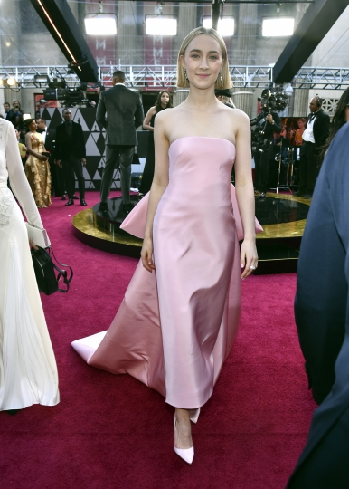 Saoirse Ronan arrives at the Oscars on Sunday, March 4, 2018, at the Dolby Theatre in Los Angeles. (Photo by Charles Sykes/Invision/AP)