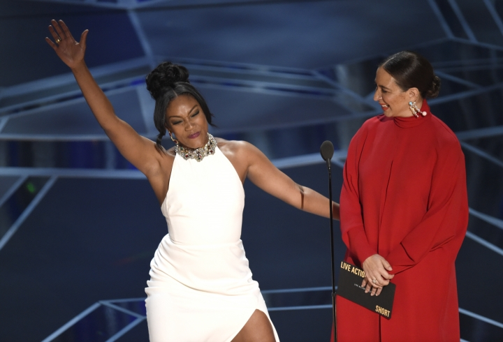 Tiffany Haddish, left, and Maya Rudolph present the award for best documentary short subject at the Oscars on Sunday, March 4, 2018, at the Dolby Theatre in Los Angeles. (Photo by Chris Pizzello/Invision/AP)