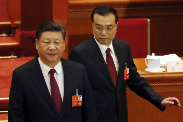 Chinese President Xi Jinping, left, and Chinese Premier Li Keqiang arrive for the opening session of the annual National People's Congress in Beijing's Great Hall of the People, Monday, March 5, 2018. (AP Photo/Ng Han Guan)
