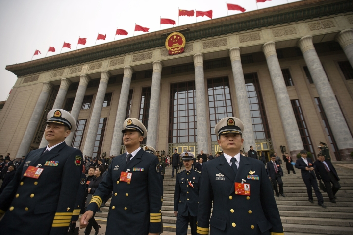 Military delegates leave after a meeting at the Great Hall of the People ahead of Monday's opening session of China's National People's Congress (NPC) in Beijing, Sunday, March 4, 2018. (AP Photo/Mark Schiefelbein)