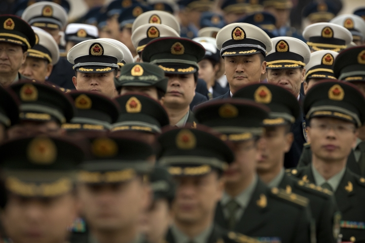 Military delegates arrive for a meeting at the Great Hall of the People ahead of Monday's opening session of China's National People's Congress (NPC) in Beijing, Sunday, March 4, 2018. China has no desire to overturn the existing international order and its increasingly powerful military does not constitute a threat to others, the spokesman for the country's ceremonial legislature said Sunday. (AP Photo/Mark Schiefelbein)
