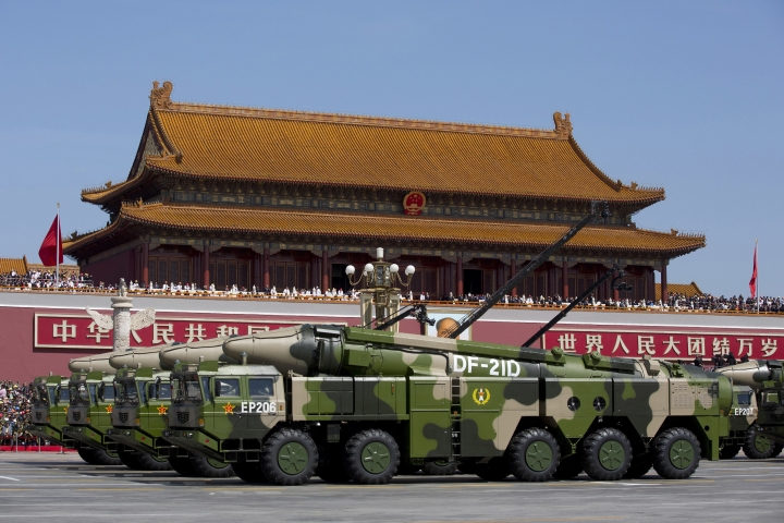 FILE - In this Sept. 3, 2015 file photo, Chinese military vehicles carrying DF-21D anti-ship ballistic missiles, potentially capable of sinking a U.S. Nimitz-class aircraft carrier in a single strike, drive past Tiananmen Gate during a military parade to commemorate the 70th anniversary of the end of World War II, in Beijing. China's defense budget will rise 8 percent to 1.1 trillion yuan ($173 billion) this year as the country is preparing to launch its second aircraft carrier, integrating stealth fighters into its air force and fielding an array of advanced missiles able to attack air and sea targets at vast distances, according to a report released Monday, March 5, 2018. (AP Photo/Andy Wong, Pool, File)