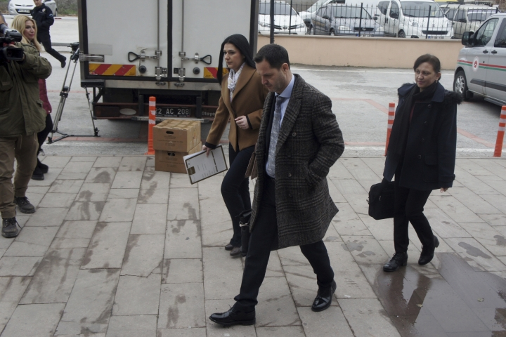 Hakan Yalcintug, center, and Simge Sandir, left, lawyers for two arrested Greek soldiers, arrive at the courthouse in Edirne, Turkey, Monday, March 5, 2018. The lawyers for two Greek soldiers arrested in Turkey have formally requested their release from custody. The two were arrested last week for allegedly entering a Turkish military zone and on suspicion of attempted espionage. (AP Photo/Ergin Yildiz)