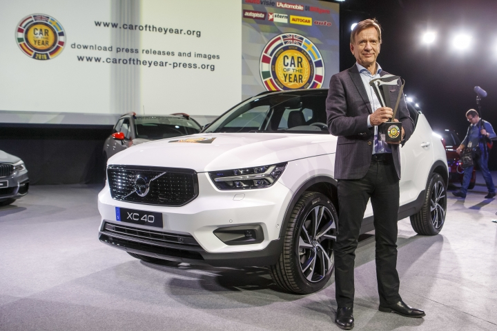 """Hakan Samuelsson, CEO of Volvo Car Group, poses with the winner's trophy next to Volvo XC40 model after it was elected """"Car of the Year 2018"""", ahead of the 88th Geneva International Motor Show, at the Palexpo, in Geneva, Switzerland, Monday, March 5, 2018. (Salvatore Di Nolfi/Keystone via AP)"""