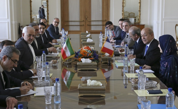 Iranian Foreign Minister Mohammad Javad Zarif, third left, and his French counterpart Jean-Yves Le Drian, second right, and their delegations meet in Tehran, Iran, Monday, March 5, 2018. Le Drian arrived in Tehran amid French criticism of Tehran's ballistic missile program. His one-day trip highlights the balancing act Paris finds itself in after Iran's 2015 nuclear deal with world powers. (AP Photo/Vahid Salemi)
