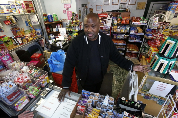 "In this Feb. 26, 2018 photo, Carl Lewis talks in his market in Rankin, Pa. About half of Lewis' customers pay with benefits from the federal Supplemental Nutrition Assistance Program, so the government's proposal to replace the debit card-type program with a pre-assembled box of shelf-stable goods delivered to recipients worries him and other grocery operators in poor areas. ""If half your business goes away, it's going to hurt,"" Lewis said. (AP Photo/Gene J. Puskar)"