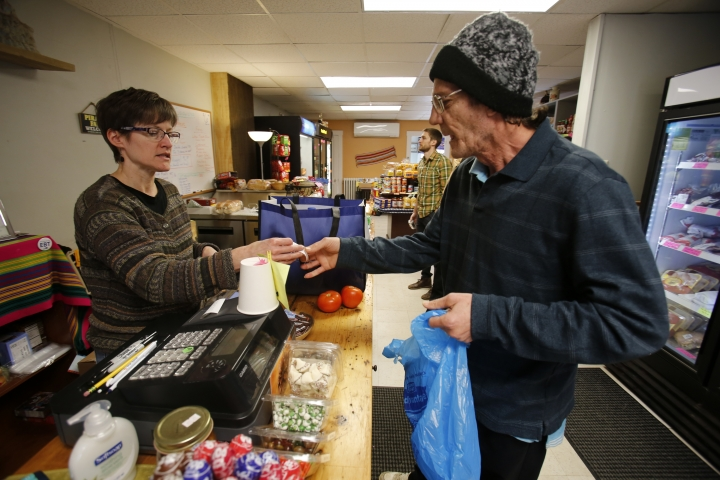 "ADDS THAT HAZELWOOD IS A NEIGHBORHOOD OF PITTSBURGH - In this Feb. 26, 2018 photo Dianne Shenk, left, helps a customer Terry Warby in Dylamatos Market in the Hazelwood neighborhood of Pittsburgh. About a quarter of Shenk's customers pay with benefits from the federal Supplemental Nutrition Assistance Program, so the government's proposal to replace the debit card-type program with a pre-assembled box of shelf-stable goods delivered to recipients concerns her and other grocery operators in poor areas. ""These boxes will be full of shelf-stable items, the same things we're being told not to eat,"" she said. (AP Photo/Gene J. Puskar)"