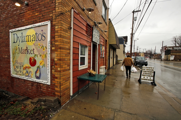 "ADDS THAT HAZELWOOD IS A NEIGHBORHOOD OF PITTSBURGH - In this March 1, 2018 photo, a customer leaves Dylamatos Market owned by Dianne Shenk in the Hazelwood neighborhood of Pittsburgh. About a quarter of Shenk's customers pay with benefits from the federal Supplemental Nutrition Assistance Program, so the government's proposal to replace the debit card-type program with a pre-assembled box of shelf-stable goods delivered to recipients worries her and other grocery operators in poor areas. ""These boxes will be full of shelf-stable items, the same things we're being told not to eat,"" she said. (AP Photo/Gene J. Puskar)"