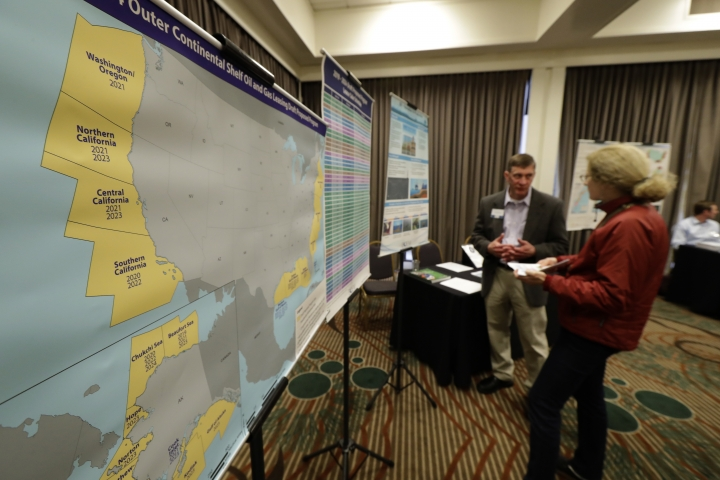 Areas that could potentially be leased for offshore oil and gas drilling are shown in yellow on a map displayed Monday, March 5, 2018, at an open house hosted by the federal Bureau of Ocean Energy Management to provide information and gather public comment on the Trump administration's proposal to expand offshore oil drilling off the Pacific Northwest coast. (AP Photo/Ted S. Warren)