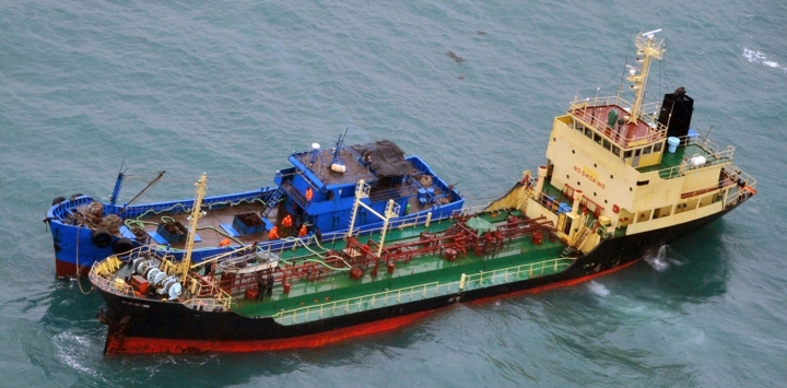 FILE - This Feb. 16, 2018, file photo released by Japan's Ministry of Defense, shows what it says is North Korean-flagged tanker Yu Jong 2, bottom, and Min Ning De You 078 lying alongside in the East China Sea performing a ship-to-ship transfer. China's government said Tuesday, March 6, 2018, it asked for a temporary hold on a U.S. request for United Nations sanctions against ships accused of violating trade restrictions on North Korea while it studies what entities are involved. (Ministry of Defense via AP, File)