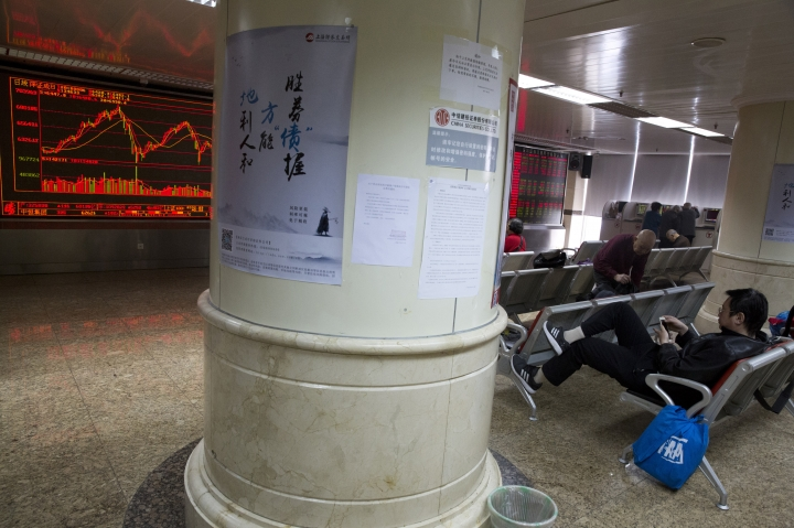 Chinese investors monitor stock market prices displayed at a brokerage in Beijing, Tuesday, March 6, 2018. Asian stock markets surged Tuesday despite U.S.-Chinese trade tensions after Wall Street posted its strongest gains in a week. (AP Photo/Ng Han Guan)