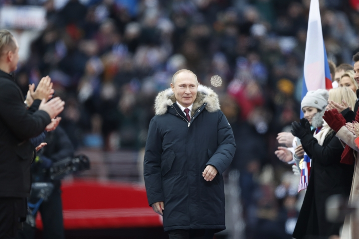 Russian President Vladimir Putin arrives to attend a massive rally in his support as a presidential candidate at the Luzhniki stadium in Moscow, Russia, Saturday, March 3, 2018. (AP Photo/Pavel Golovkin)