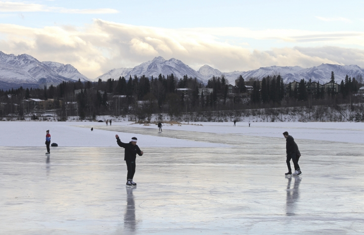 FILE - In this Jan. 2, 2018, file photo, ice skaters take advantage of unseasonable warm temperatures to ice skate outside at Westchester Lagoon in Anchorage, Alaska. New U.S. weather data shows that the Arctic just finished its warmest winter on record, with plenty of open water where the ocean normally freezes. The National Snow and Ice Data Center said Tuesday, March 6, the extent of Arctic sea ice in February was 62,000 square miles (160,000 square kilometers) smaller than last year's record low. (AP Photo/Mark Thiessen, File)