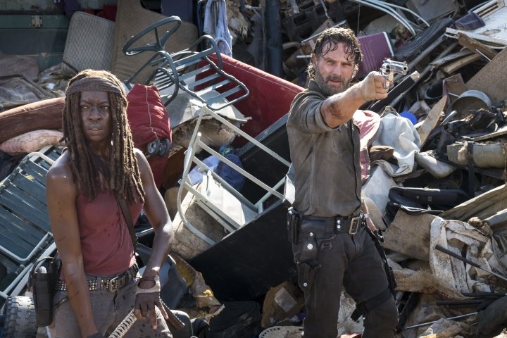 """In this image released by AMC, Danai Gurira, left, and Andrew Lincoln appear in a scene from """"The Walking Dead."""" The Nielsen company says the latest episode of the AMC series was seen by 6.8 million viewers on Sunday. That's the show's smallest audience since 2012, and the worst showing among the youthful 18-to-49-year-old demographic since 2010. (Gene Page/AMC via AP)"""