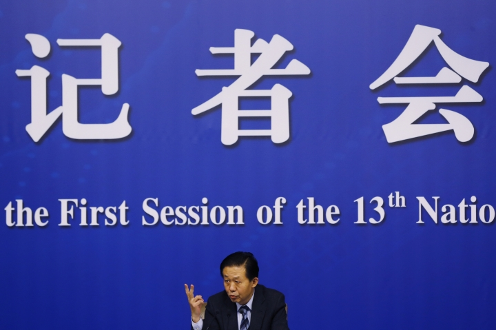 China's Finance Minister Xiao Jie speaks during a press conference on the sidelines of the National People's Congress at the media center in Beijing, Wednesday, March 7, 2018. Xiao tried Wednesday to defuse concern over the country's rising debt, saying government borrowing is below danger levels and regulators can prevent financial system risks. (AP Photo/Andy Wong)