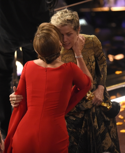 """Allison Janney, left, congratulates Frances McDormand as she accepts the award for best performance by an actress in a leading role for """"Three Billboards Outside Ebbing, Missouri"""" at the Oscars on Sunday, March 4, 2018, at the Dolby Theatre in Los Angeles. (Photo by Chris Pizzello/Invision/AP)"""