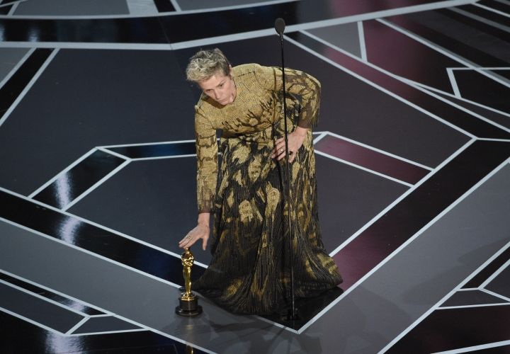 """Frances McDormand places her award for best performance by an actress in a leading role for """"Three Billboards Outside Ebbing, Missouri"""" on the stage at the Oscars on Sunday, March 4, 2018, at the Dolby Theatre in Los Angeles. (Photo by Chris Pizzello/Invision/AP)"""