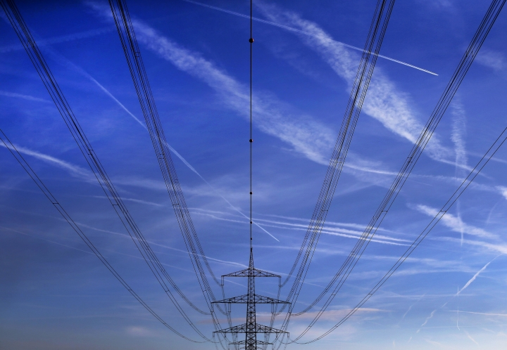 FILE - In this Nov. 1, 2017 file photo high power cables hang from a pole on a field in Hattersheim, Germany. Millions of Europeans who arrived late to work or school Wednesday March 7, 2018 have a good excuse: an unprecedented slowing of the frequency of the continent's electricity grid. The Brussels-based European Network of Transmission System Operators for Electricity, or ENTSO-E, says the problem began mid-January and affects 25 countries, from Portugal to Poland and Greece and Germany. (AP Photo/Michael Probst,file)