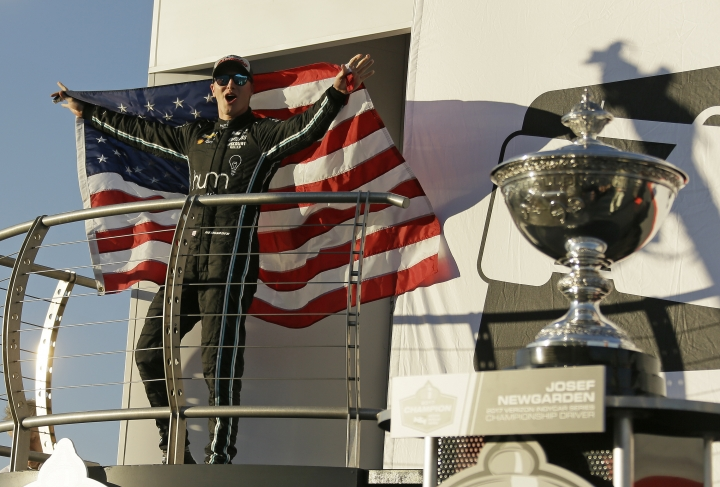 FIEL - In this Sept. 17, 2017, file photo, Josef Newgarden celebrates after winning the IndyCar championship in Sonoma, Calif. Newgarden brings IndyCar into the season-opening race through the temporary course on the streets of St. Petersburg as the series' reigning champion. (AP Photo/Eric Risberg, File)