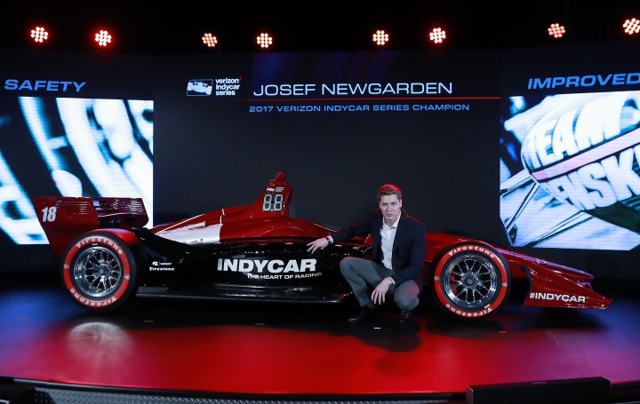 FILE - In this Jan. 16, 2018, file photo, Josef Newgarden, 2017 Verizon IndyCar Series champion, describes the advantages of the new race car setup during the North American International Auto Show in Detroit. Newgarden brings IndyCar into the season-opening race through the temporary course on the streets of St. Petersburg as the series' reigning champion. (AP Photo/Carlos Osorio, File)