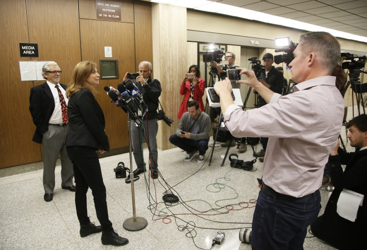 Attorney Daniel Brookman, from left, and Rabbi Naomi Levy appear on behalf of defendant Terry Bryant, as the media awaits Bryant's appearance in Los Angeles Superior Court Wednesday, March 7, 2018. Bryant is accused of stealing Frances McDormand's best actress Oscar statuette during the Governors Ball after party on Sunday. (AP Photo/Damian Dovarganes)