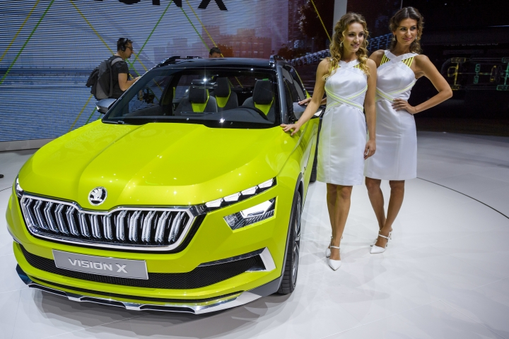 Two hostess pose next to the new Skoda Vision X, during the press day at the 88th Geneva International Motor Show in Geneva, Switzerland, Tuesday, March 6, 2018. The Motor Show will open its gates to the public from March 8 to March 18 presenting more than 180 exhibitors and more than 110 world and European premieres. (Martial Trezzini/Keystone via AP)
