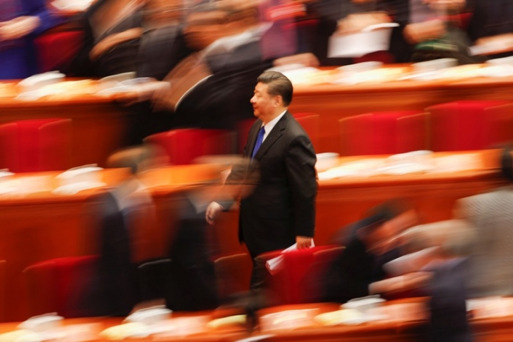 Chinese President Xi Jinping leaves after the opening session of the Chinese People's Political Consultative Conference (CPPCC) at the Great Hall of the People in Beijing. REUTERS/Damir Sagolj