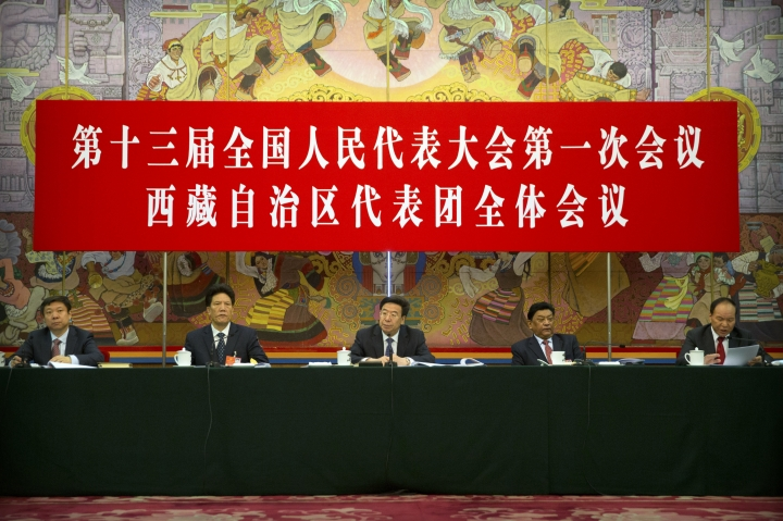Wu Yingjie, center, party secretary of the Tibetan Autonomous Region, and other officials attend a group discussion session held on this sidelines of the annual meeting of China's National People's Congress (NPC) in the Tibet Hall of the Great Hall of the People in Beijing, Thursday, March 8, 2018. (AP Photo/Mark Schiefelbein)