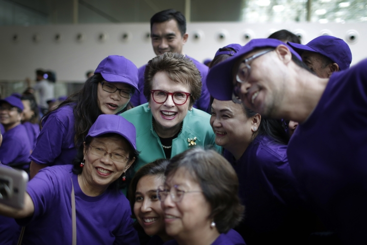 Billie Jean King, founder of the Women's Tennis Association (WTA) and former World No. 1 professional tennis player, poses with fans during an event organized by the WTA to launch the last edition of the WTA Finals in Singapore, before it moves to Shenzhen in 2019, as well as to commemorate International Women's Day Thursday, March 8, 2018, in Singapore. (AP Photo/Wong Maye-E)