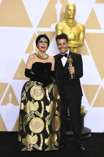 "Presenter Rita Moreno, left, and Sebastian Lelio, winner of the award for best foreign language film for ""A Fantastic Woman"", pose in the press room at the Oscars on Sunday, March 4, 2018, at the Dolby Theatre in Los Angeles. (Photo by Jordan Strauss/Invision/AP)"