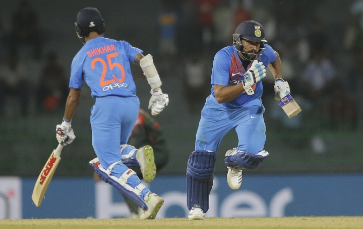 India's Rohit Sharma, right, and Shikhar Dhawan run between wickets against Bangladesh during their Twenty20 cricket match in Nidahas triangular series in Colombo, Sri Lanka, Thursday, March 8, 2018. (AP Photo/Eranga Jayawardena)