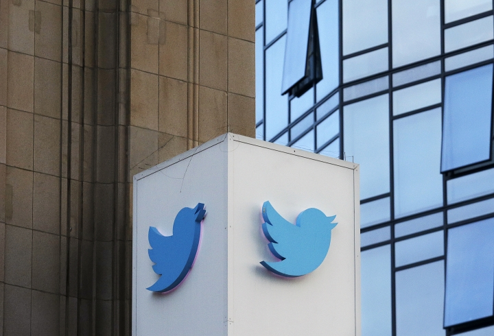 FILE - This Oct. 26, 2016 file photo shows a Twitter sign outside of the company's headquarters in San Francisco. A new study published Thursday, March 8, 2018, in the journal Science shows that false information on the social media network travels six times faster than the truth and reaches far more people. (AP Photo/Jeff Chiu), File
