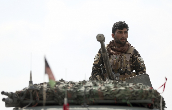 A soldier stands guard near the site of a suicide attack in Kabul, Friday, March 9, 2018. A suicide bomber targeting Afghanistan's minority Hazaras blew himself up at a police checkpoint in western Kabul on Friday, killing nine people and wounding more than a dozen, officials said. (AP Photo/Massoud Hossaini)