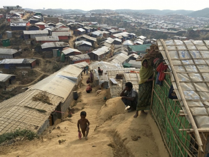 A boy climbs up a steep hillside in Chakmakul camp for Rohingya refugees in southern Bangladesh, February 8, 2018.   REUTERS/Andrew RC Marshall