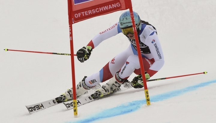 Switzerland's Wendy Holdener speeds down the course during an alpine ski, women's World Cup giant slalom, in Ofterschwang, Germany, Friday, March 9, 2018. (AP Photo/Marco Tacca)