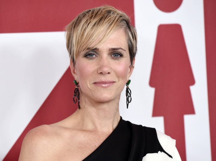 """FILE - In this Dec. 18, 2017 file photo, Kristen Wiig, a cast member in """"Downsizing,"""" poses at a special screening of the film in Los Angeles. Wiig will play a villain in the next """"Wonder Woman"""" film. Director Patty Jenkins announced on Twitter Friday that Wiig will star as Wonder Woman rival Cheetah in the superhero sequel. (Photo by Chris Pizzello/Invision/AP, File)"""