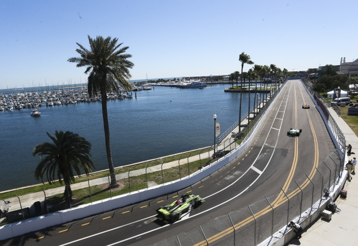 The streets of St. Petersburg are roaring as the track goes hot as IndyCars make their way toward turn 10 during the first IndyCar practice on the first day of the Firestone Grand Prix of St. Petersburg, Fla., Friday, March 9, 2018. (Dirk Shadd/The Tampa Bay Times via AP)