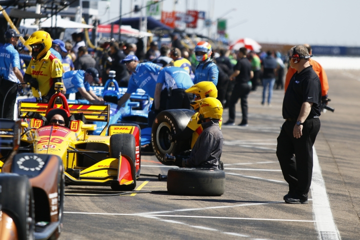 IndyCar crew do last minute adjustments to cars before the start of the morning practice session on the first day of the Firestone Grand Prix of St. Petersburg, Fla., Friday, March 9, 2018. (Luis Santana/The Tampa Bay Times via AP)
