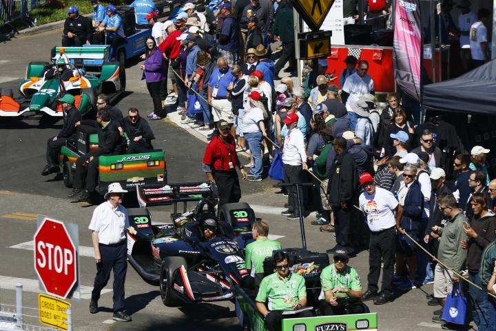 IndyCars are towed to the paddock before the start of the morning practice session on the first day of the Firestone Grand Prix of St. Petersburg Friday, March 9, 2018. (Luis Santana/The Tampa Bay Times via AP)