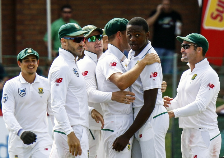South Africa's bowler Kagiso Rabada, second right, with teammate celebrates after dismissing Australia's batsman Shaun Marsh, for 24 runs on the first day of the second cricket test match between South Africa and Australia at St George's Park in Port Elizabeth, South Africa, Friday, March 9, 2018. (AP Photo/Michael Sheehan)