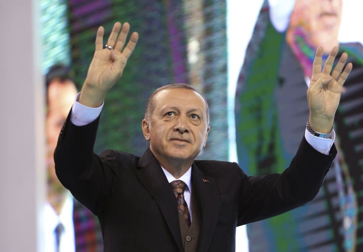 "Turkey's President Recep Tayyip Erdogan, waves as he arrives to deliver a speech at a rally of his ruling Justice and Development (AKP) Party's supporters, in Mersin, southern Turkey, Saturday, March 10, 2018. Erdogan has criticised NATO for not supporting the country's ongoing military operation against the Syrian Kurdish People's Protection Units or YPG, that started Jan. 20, to clear them from Afrin in northwestern Syria. Erdogan asked, ""Hey NATO, where are you?"" and accused the alliance of double standards.(Pool Photo via AP)"