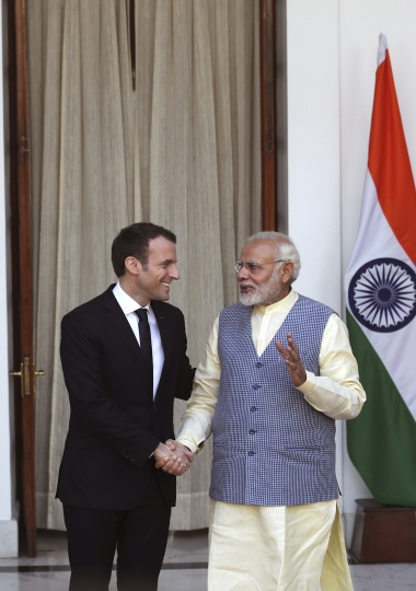 Indian Prime Minister Narendra Modi, right, shakes hand with French President Emmanuel Macron before their meeting in New Delhi, India, Saturday, March 10, 2018. Macron who is on a four-day state visit is expected to hold talks with Indian Prime Minister Narendra Modi and co-chair the Founding Conference of the International Solar Alliance. (AP Photo/Manish Swarup)