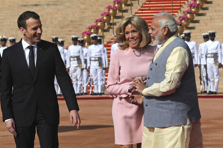 French President Emmanuel Macron, left, and wife Brigitte talks to Indian Prime Minister Narendra Modi during the ceremonial reception of Macron at the Indian presidential palace in New Delhi, India, Saturday, March 10, 2018. Macron who is on a four-day state visit is expected to hold talks with Indian Prime Minister Narendra Modi and co-chair the Founding Conference of the International Solar Alliance. (AP Photo/Manish Swarup)
