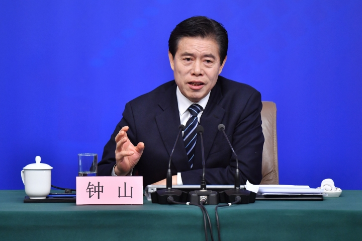 "In this photo released by China's Xinhua News Agency, Chinese Minister of Commerce Zhong Shan speaks at a press conference in Beijing, Sunday, March 11, 2018. China says it will not initiate a ""disastrous"" trade war with the United States, but is vowing to defend its national interests in the face of growing American protectionism. (Li Xin/Xinhua via AP)"
